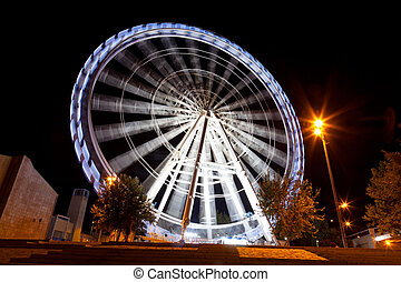 Working big wheel at night in Zaragoza, Spain