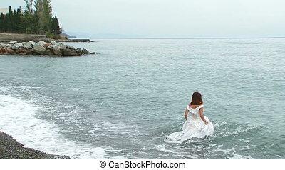 Beautiful Woman In White Dress Swimming In Sea