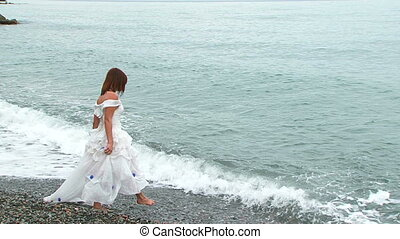 Beautiful Woman In White Dress Walking Into Sea - Beautiful...