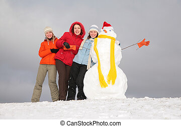 three young women and snowman 3