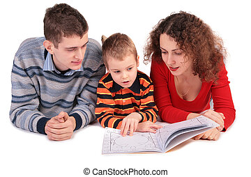 parents look book with son