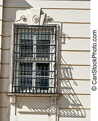 bars on a window - grating in front of a window, symbolic...