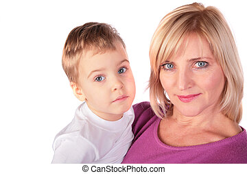Woman with kid faces close-up - middleaged woman in pink...