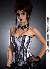 Elegant young woman in black and white corset - Elegant...