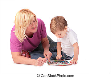 middleaged woman in pink shirt with kid, my photo on magazine