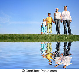family grass sky water