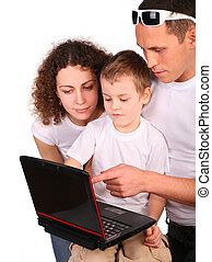 parents with son look at notebook