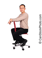 Young man sits on red chair sideview