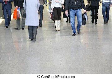 pedestrians walk on street