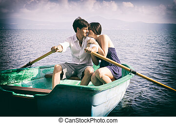 Couple in love cuddling on boat in vacation