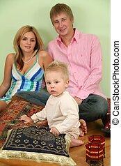 family sit on floor on pillow 2