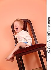 child cry scream on fall chair