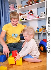 father and child in playroom 3