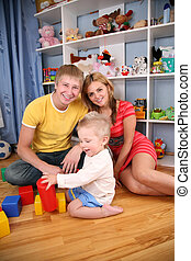 parents and child in playroom