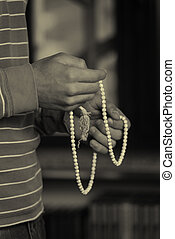 Young Muslim Man With Rosary Praying
