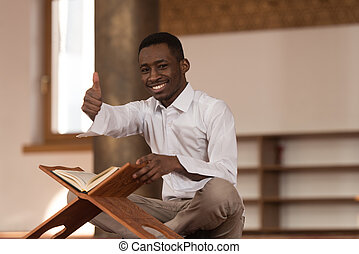 Black African Muslim Man Showing Thumbs Up - Black African...