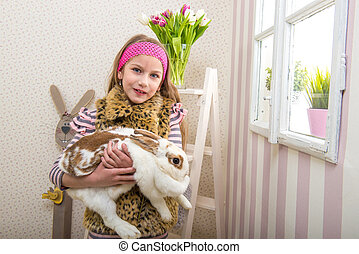 Easter - Girl carries a huge rabbit live