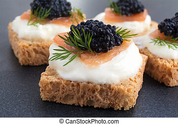 Caviar - Canape of Caviar on top of salmon with cream...