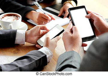 group of business people using smartphone