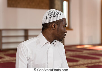 African Muslim Praying In Mosque - African Muslim Man Making...