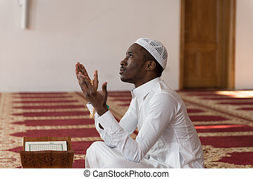 African Muslim Man Is Praying In The Mosque - African Muslim...