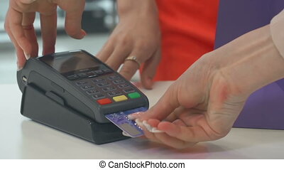 Payment by Bank Card - Extreme close-up of plastic card put...