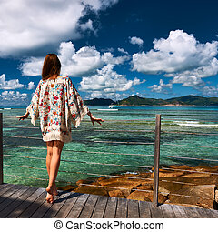 Woman on a beach jetty at Seychelles, La Digue. - Woman with...