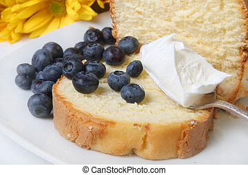 Blueberry shortcake - Slice of pound cake with spoonfull of...