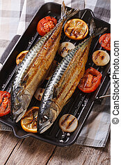 grilled sea fish and vegetables in a pan grill, vertical top...