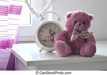 Romantic still life with alarm clock and pink teddy bear -...