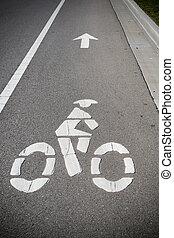 Bike lane marker on roadway - A bike lane or bikeway symbol...