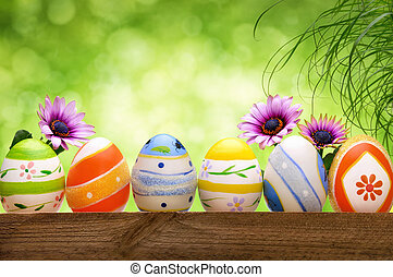 Easter eggs, flowers and bokeh background