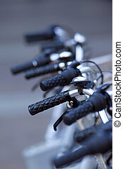 Handlebars of parked bicycles in the city
