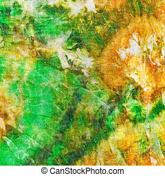 abstract pattern of green yellow batik painted on silk close...