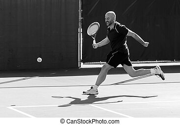 Tennis player striving in a match