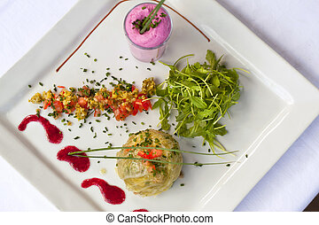 Gastronomic dish - Stuffed cabbage, beet mousse and green...