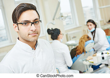 Young asian dentist doctor - Portrait of male asian dentist...