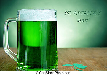 st patricks day - a glass mug with dyed green beer and a...