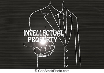 business man handing out the word Intellectual Property -...