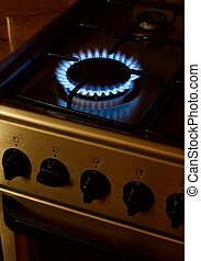 Gas burner of a stove glowing in the evening