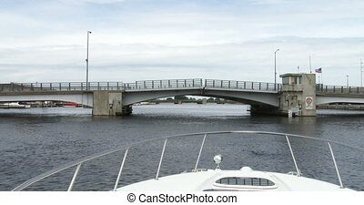 Lift bridge opening slowly seen from navigating boat