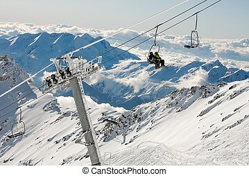 Skiing - Ski resort in the high mountains with ski lift