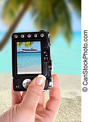 Taking picture ofl ship and beach - Taking picture of cruise...