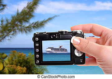 Tropical ship snapshot - Woman taking picture of cruise ship...