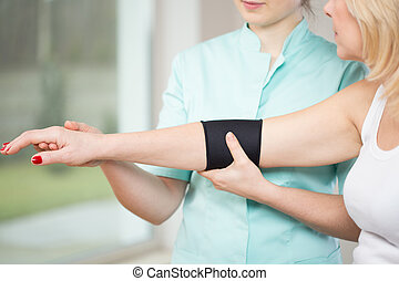 Using elbow stabilizer - Image of patient after injury using...