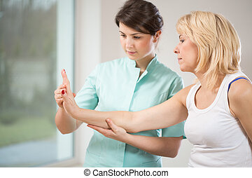 Rehabilitation after wrist injury - Blonde woman during...