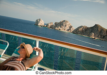 Beautiful Woman Relaxes on a Cruise Ship Deck at Lands End...