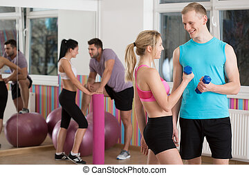 Flirting during fitness classes - Two couples flirting...