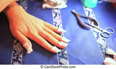 step of manicure process Nail gel removal using foil pieces...