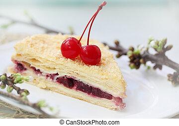 Napoleon dessert - Napoleon cake with cherries on a plate